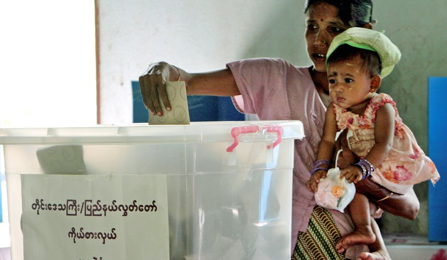 "A Burmese woman casts her ballot in Bago, Burma, on Sunday. President Obama, during his visit to India, said the election was rigged by the ruling junta and ""anything but free and fair."" (Associated Press)"