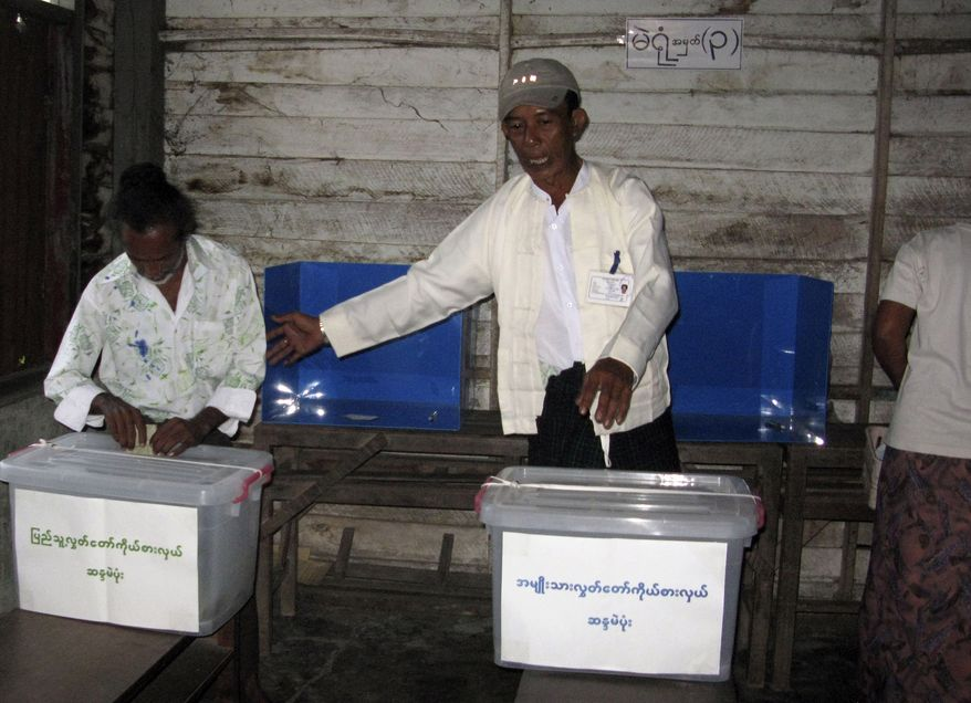 Myanmar voters cast ballots Sunday at a local polling station in Yangon, Myanmar. Voters in Myanmar's first elections in 20 years cast their ballots Sunday amid a barrage of criticism that the balloting was rigged in favor of the ruling military, as well as hope that some change toward democratic reform might nonetheless follow. (Associated Press)