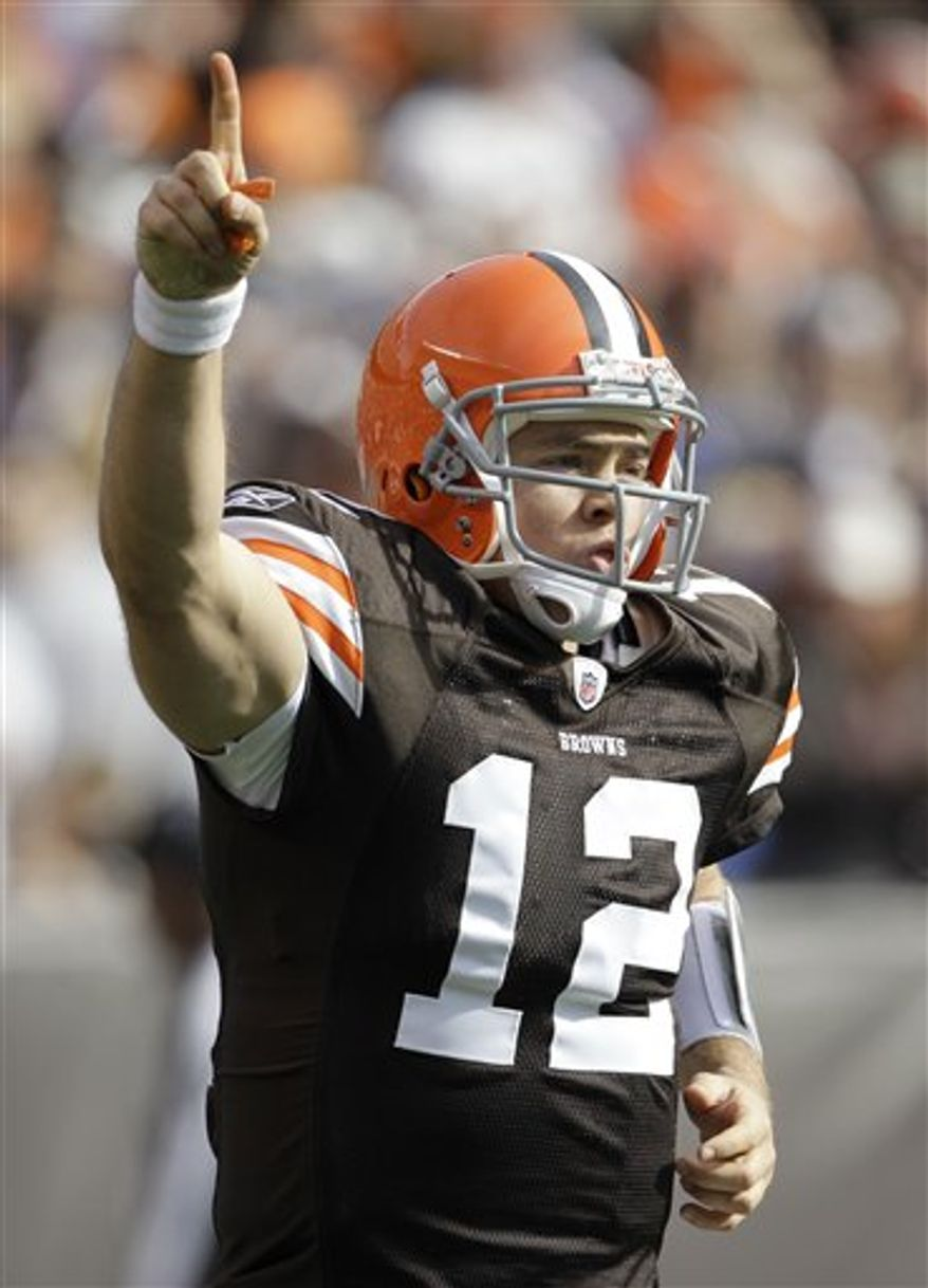 Cleveland Browns coach Eric Mangini is all smiles as he leaves the field after a 34-14 win over the New England Patriots in an NFL football game  Sunday, Nov. 7, 2010, in Cleveland. (AP Photo/Tony Dejak)