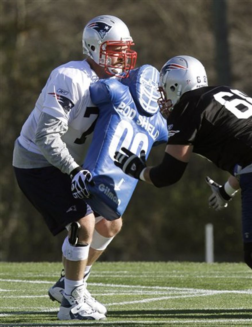New England Patriots guard Logan Mankins, left, performs field drills with teammate Thomas Austin, right, during NFL football practice in Foxborough, Mass., Wednesday, Nov. 3, 2010. Mankins returned to the team Tuesday and practiced Wednesday after accepting a tender offer from the Patriots.  (AP Photo/Steven Senne)
