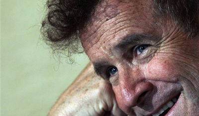 """In this photo of Wednesday Nov. 3, 2010 South African musician Johnny Clegg speaks during an interview with the Associated Press at his house in Johannesburg, South Africa. Clegg, later dubbed the """"white Zulu,"""" was sure his song's message would be lost. At the time, his new genre of music, a blend of Western pop and Zulu rhythms, was banned from the radio _ as Mandela's photo was banned from newspapers. Clegg's concerts were routinely broken up, and he and other members of his multiracial band had been arrested several times for challenging a South African law meant to keep whites and blacks apart. (AP Photo/Themba Hadebe)"""