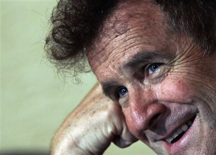 "In this photo of Wednesday Nov. 3, 2010 South African musician Johnny Clegg speaks during an interview with the Associated Press at his house in Johannesburg, South Africa. Clegg, later dubbed the ""white Zulu,"" was sure his song's message would be lost. At the time, his new genre of music, a blend of Western pop and Zulu rhythms, was banned from the radio _ as Mandela's photo was banned from newspapers. Clegg's concerts were routinely broken up, and he and other members of his multiracial band had been arrested several times for challenging a South African law meant to keep whites and blacks apart. (AP Photo/Themba Hadebe)"