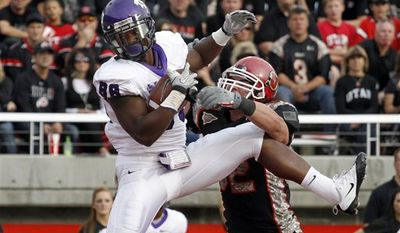 TCU wide receiver Jimmy Young (88) catches a touchdown pass while being defended by Utah linebacker Chaz Walker (32) during the second half of their NCAA college football game Saturday, Nov. 6, 2010, in Salt Lake City.  TCU won 47-7. (AP Photo/Jim Urquhart)