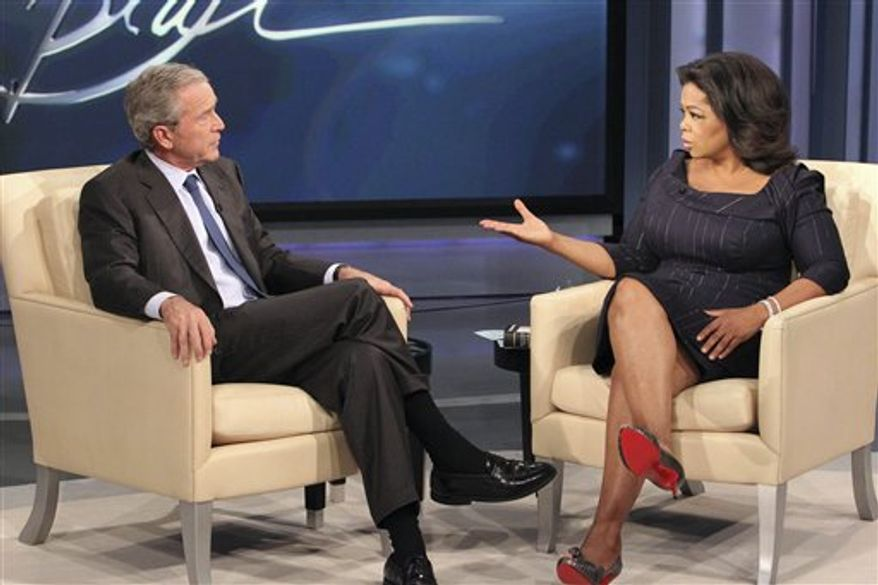 """This photo taken Oct. 28, 2010 and provided by Harpo Productions Inc.,  shows talk-show host Oprah Winfrey interviewing former President George W. Bush during taping of """"The Oprah Winfrey Show"""" at Harpo Studios in Chicago. The show will air nationally on Tuesday, Nov. 9, 2010. (AP Photo/Harpo Productions Inc., George Burns)  NO SALES"""