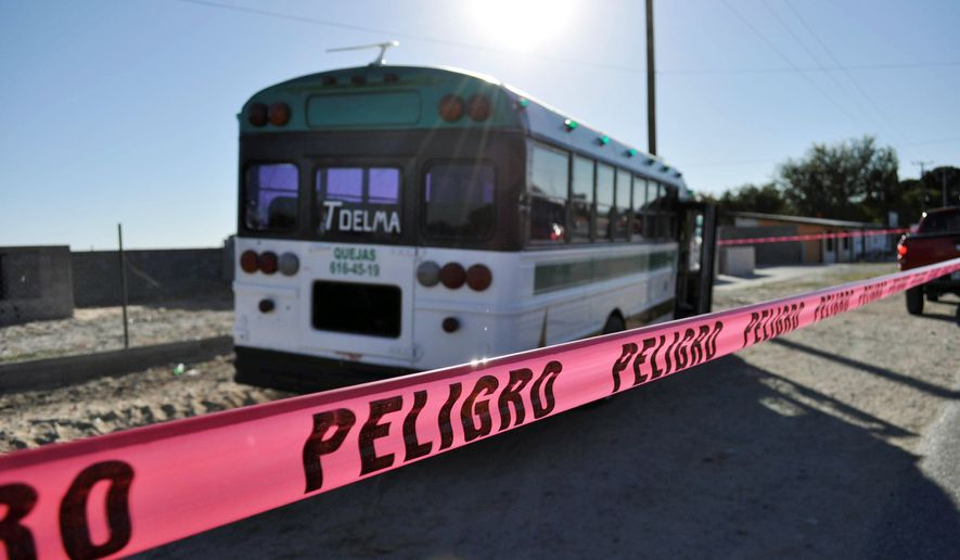 Police tape blocks the site where gunmen fired on two buses carrying factory workers on Oct. 28, killing four and wounding more than a dozen. Drug cartels are disrupting everyday life with violence used to keep others out of rural areas they use. (Associated Press)