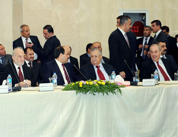 Leaders of Iraq's main political blocs meeting Monday are (front row, from left) ex-Prime Minister Ibrahim Jafari, Prime Minister Nouri al-Maliki, President Jalal Talabani and ex- Prime Minister Ayad Allawi. (Iraqi government via Associated Press)