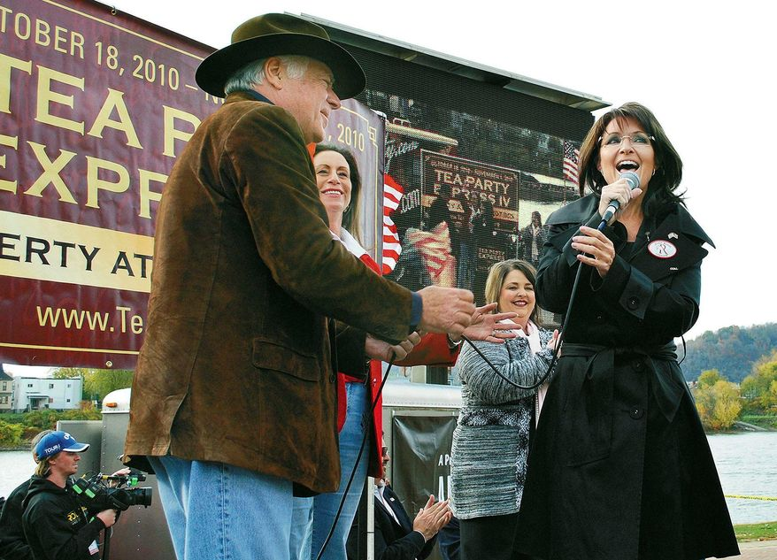 """Former Alaska Gov. Sarah Palin, seen here campaigning in West Virginia last month, is on almost everyone's list as a possible contender for president in 2012, says Republican Texas Gov. Rick Perry. He notes that with """"tea party"""" ties, she """"continues to confound the establishment and that is a good thing."""" (Associated Press)"""