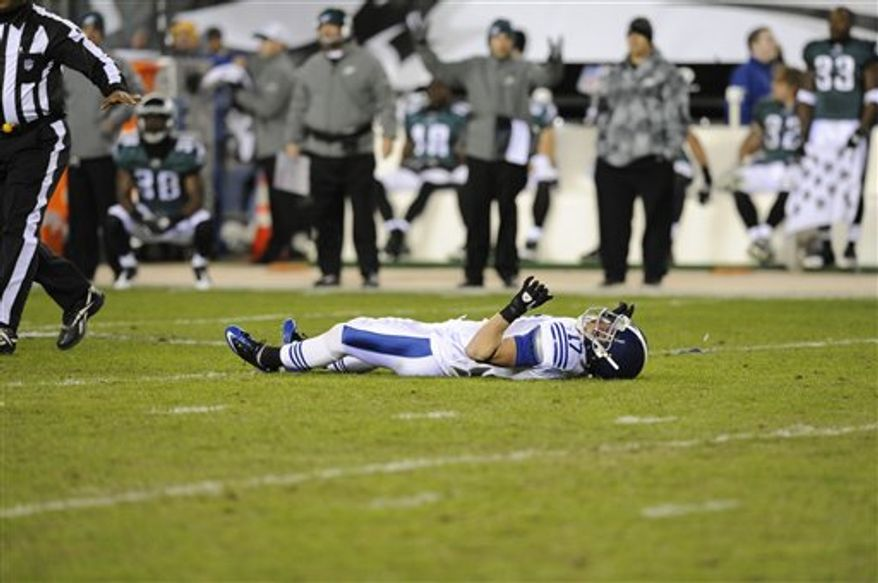 In this photo taken Nov. 7, 2010 Indianapolis Colts wide receiver Austin Collie lies on the field after being injured in the first half of an NFL football game against the Philadelphia Eagles in Philadelphia. (AP Photo/Miles Kennedy)