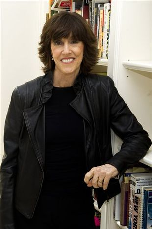 In this Nov. 3, 2010 photo, author, filmmaker and Huffington Post editor-at-large Nora Ephron poses for a photo at her home in New York. (AP Photo/Charles Sykes)
