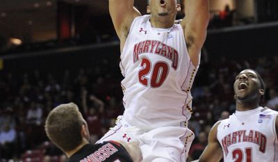 ** FILE ** Maryland's Jordan Williams (20) dunks against Seattle's Chad Rasmussen (15) during the first half of an NCAA college basketball game, Monday, Nov. 8, 2010, in College Park, Md. Also seen is Maryland's Pe'Shon Howard (21). (Associated Press)