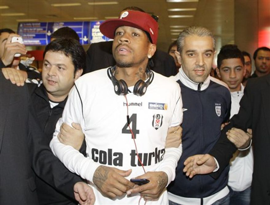Former NBA star Allen Iverson is surrounded by cheering supporters of Besiktas at the Ataturk airport in Istanbul, Turkey, Monday, Nov. 8, 2010. Iverson signed a two-year $4 million contract to play for the Turkish basketball team Besiktas. (AP Photo/Ibrahim Usta)