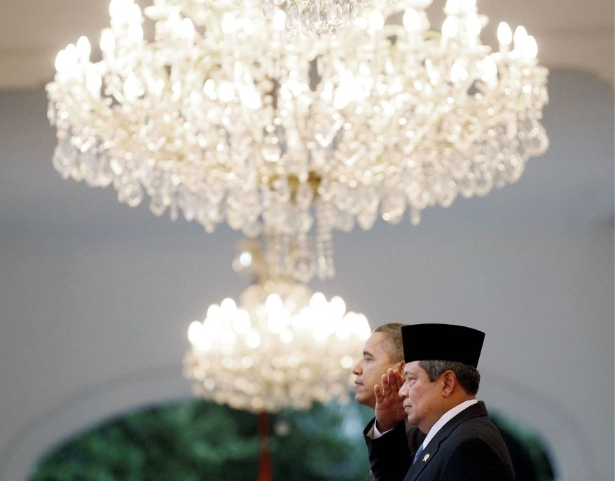President Obama and Indonesian President Susilo Bambang Yudhoyono attend the official arrival ceremony at State Palace Complex-Istana Merdeka in Jakarta, Indonesia, on Tuesday. (Associated Press)