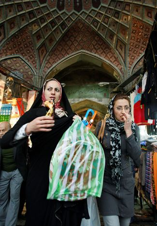 """Shoppers at Iran's main bazaar find their money buys much less, and the expectation is for worse to come. """"How much can we stand?"""" one woman asked. """"People are very angry and very worried."""" (Associated Press)"""