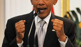 U.S. President Barack Obama answers a question from a journalist during a joint press conference with his Indonesian counterpart Susilo Bambang Yudhoyono in Jakarta on Tuesday November 9, 2010. (AP Photo/Bay ISMOYO, Pool)