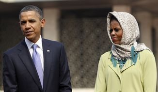 President Obama and first lady Michelle Obama visit Istiqlal Mosque in Jakarta, Indonesia, on Wednesday. (Associated Press)