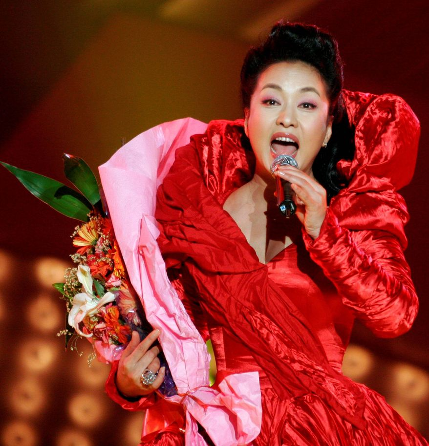 Peng Liyuan, wife of Chinese Vice President Xi Jinping, seen here performing in Luoyang, China, in April 2007, is beloved by millions in China, but it's widely expected she will keep fading from public view as Mr. Xi's political star continues to rise. (Associated Press)