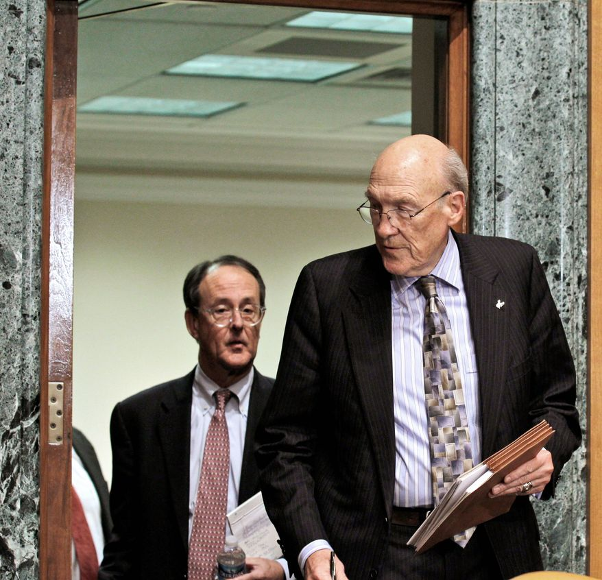 Erskine Bowles (left) and former Wyoming Sen. Alan Simpson, co-chairmen of President Obama's bipartisan deficit commission, arrive for a news conference on Capitol Hill on Thursday. (Associated Press)