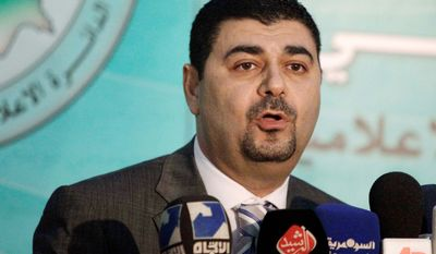 Government spokesman Haider al-Mullah speaks to the news media in Baghdad on Thursday. Parliament met later in the day to form a new government. (Associated Press)