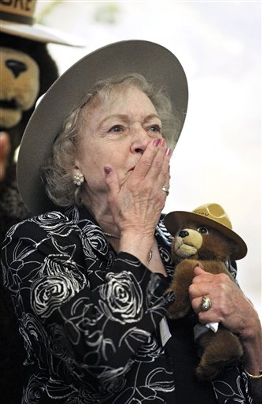 """A wooden plague given to actress Betty White is seen during a ceremony where she was named an Honorary Forest Ranger by the US Forest Service, at the Kennedy Center in Washington Washington, Tuesday, Nov. 9, 2010. White has stated in numerous interviews that her first ambition as a young girl was """"to become a forest ranger, but they didn't allow women to do that back then"""".  (AP Photo/Cliff Owen)"""