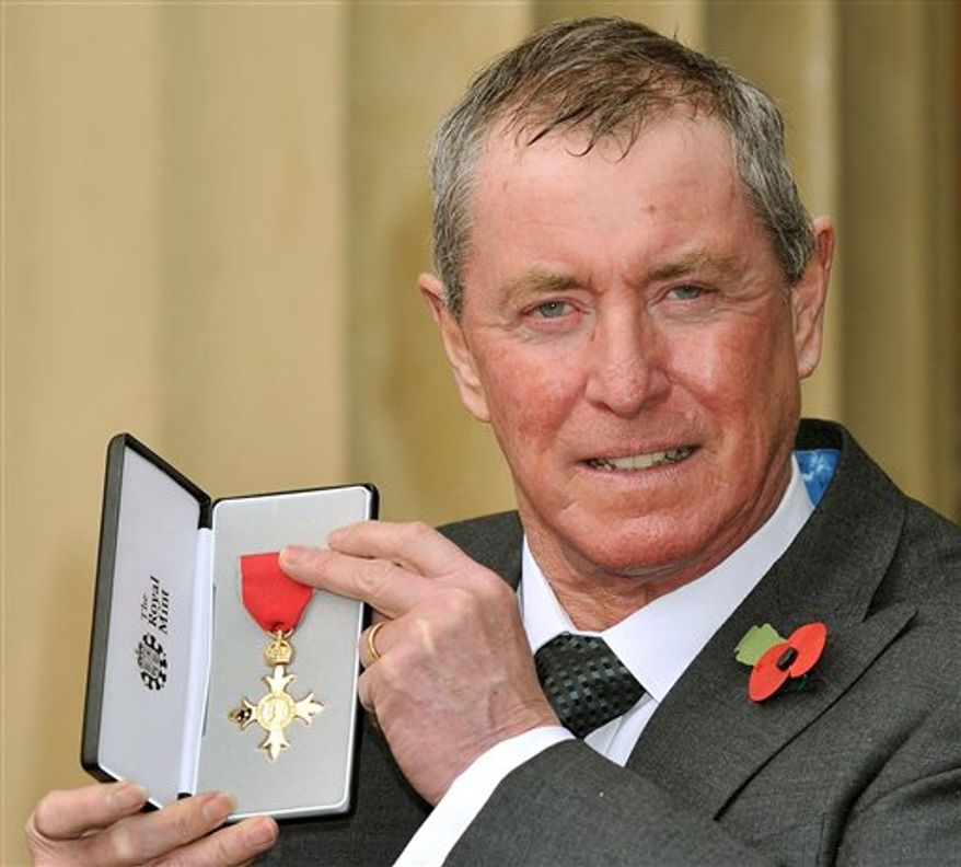 Actor John Nettles holds the insignia of Officer of the British Empire (OBE) medal, after it was presented to him by Britain's Queen Elizabeth II, at an investiture at Buckingham Palace in London, Tuesday Nov. 9, 2010.  Nettles, 67, the star of two long-running television series 'Bergerac' and 'Midsomer Murders', was awarded the honour for services to drama.(AP Photo/Stillwell, pool)