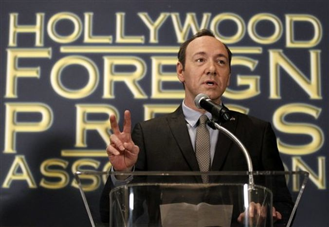 Philip Berk, president of the Hollywood Foreign Press Association, left, speaks after actor Kevin Spacey announced that Robert De Niro, will be honored with the Cecil B. DeMille Award at the 68th Annual Golden Globe Awards, in Beverly Hills, Calif., on Tuesday, Nov. 9, 2010. The Golden Globe Awards will be held on January 16, 2011, in Beverly Hills, Calif..  (AP Photo/Matt Sayles)