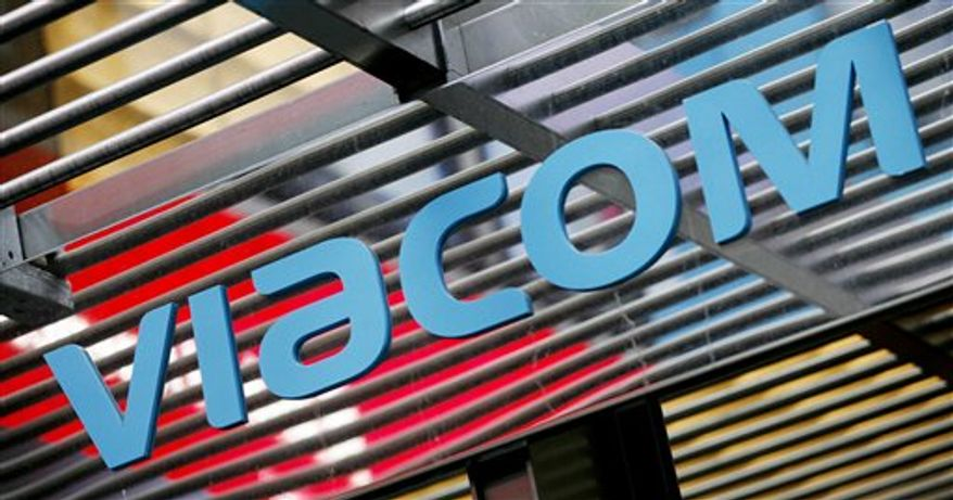FILE - In this Jan. 19, 2010 file photo, the logo above the entrance to Viacom's headquarters is shown, in New York. Viacom reports its earnings tumbled in the third quarter Thursday, Nov. 11, 2010, because of results from a division that the media company led by Sumner Redstone plans to sell.(AP Photo/Mark Lennihan, file)