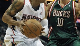 FILE-This Feb. 28, 2010 file photo shows Atlanta Hawks forward Maurice Evans, driving against Milwaukee Bucks forward Carlos Delfino (10) of Argentina, during the first quarter of an NBA basketball game at Philips Arena in Atlanta.  Evans says NBA players aren't buying commissioner David Stern's recent call for a one-third reduction in players' salaries. Evans, a vice president on the union's executive committee, also says there may not be substantial progress in the NBA labor talks before all players are available to return to the negotiations during the February All-Star break. (AP Photo/Gregory Smith,File)