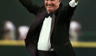 FILE - In this July 15, 1999, file photo, Dave Niehaus waves to the crowd after a surprise announcement that he would be tossing out the ceremonial first pitch at the inaugural game of the Seattle Mariners' new ballpark, Safeco Field, in Seattle. Niehaus, the legendary and beloved voice of the Mariners from their inception in 1977 through the final game of the 2010 season, has died, the ballclub confirmed Wednesday, Nov. 10, 2010. Niehaus, who received the Ford Frick Award at the Hall of Fame induction ceremony in 2008, was 75. (AP Photo/Elaine Thompson, File)