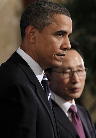 **FILE** President Obama and South Korean President Lee Myung-bak hold a joint news conference at Blue House in Seoul, South Korea, on Nov. 11, 2010. (Associated Press)