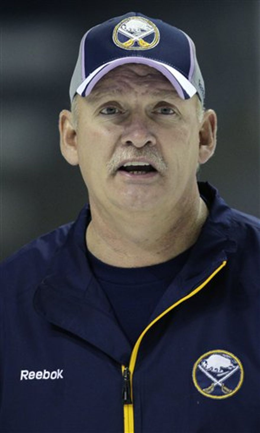 FILE - This Oct. 6, 2010, file photo shows Buffalo Sabres coach Lindy Ruff during NHL hockey practice in Buffalo, N.Y. Ruff is set become only the third NHL coach to reach 1,000 games with one team. The milestone comes Wednesday, Nov. 10, 2010, when Buffalo plays at New Jersey.  (AP Photo/David Duprey, File)
