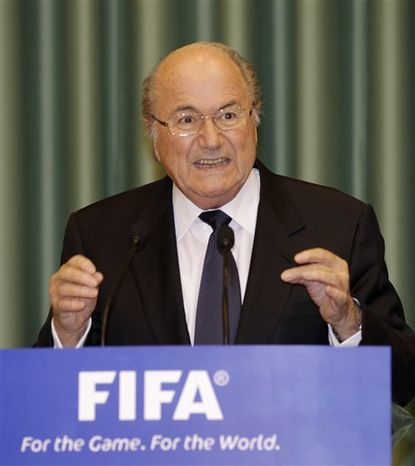 Joseph S. Blatter, president of the Federation of International Football Association, speaks during a joint press conference with South Korean President Lee Myung-bak at the presidential Blue House in Seoul, South Korea, Monday, Nov. 8, 2010.  (AP Photo/ Lee Jin-man, Pool)