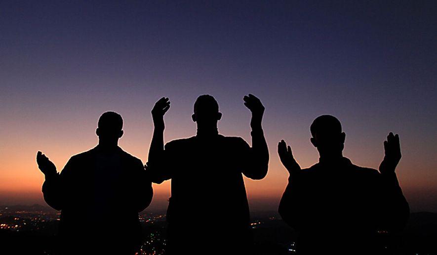 Muslim pilgrims pray on the outskirts of Mecca, Saudi Arabia. (AP Photo/Hassan Ammar)