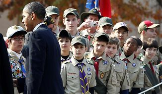 Scouts keep their eyes on President Barack Obama as he works a rope line after laying a wreath at the Yongsan War Memorial in Seoul, South Korea, Thursday, Nov. 11, 2010. (AP Photo/Charles Dharapak)