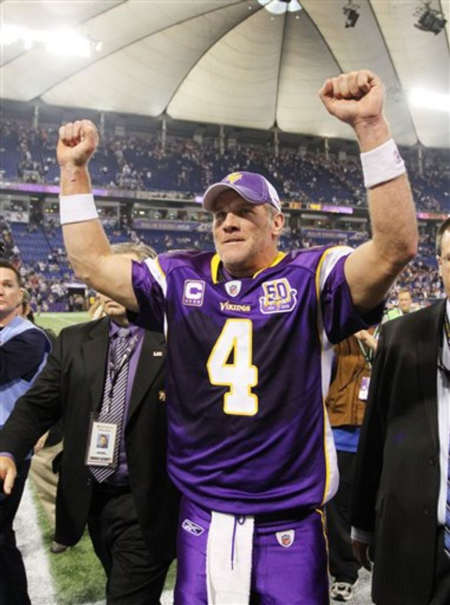 Minnesota Vikings quarterback Brett Favre leaves the field after after the Vikings defeated the Arizona Cardinals in overtime, 27-24, in an NFL football game in Minneapolis on Sunday, Nov. 7, 2010.(AP Photo/Andy King)