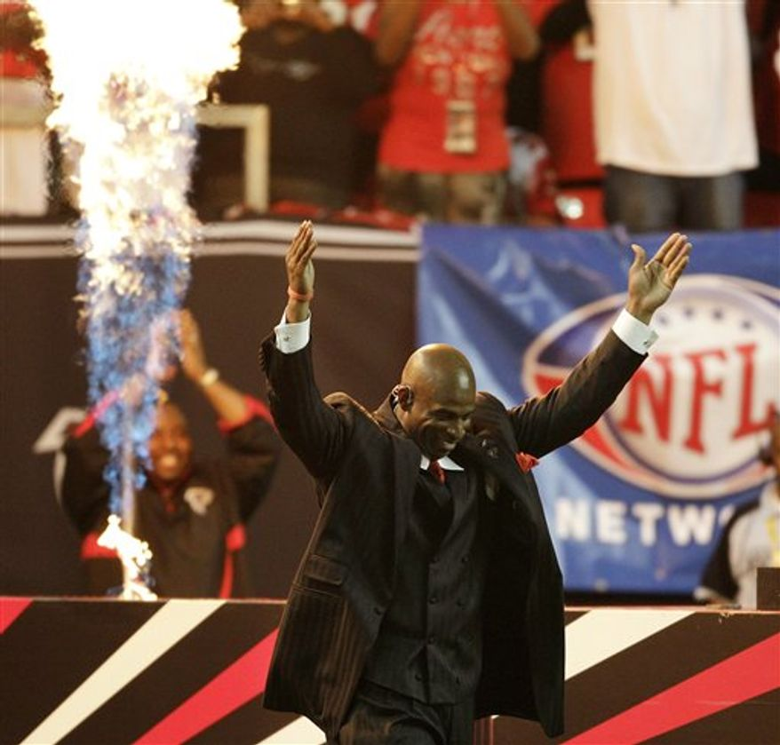 Former Atlanta Falcons player Deion Sanders walks out to the field during a halftime ceremony at an NFL football game between the Baltimore Ravens and the Atlanta Falcons, Thursday, Nov. 11, 2010 in Atlanta. Sanders was inducted into the Falcons' ring of honor. (AP Photo/David Goldman)