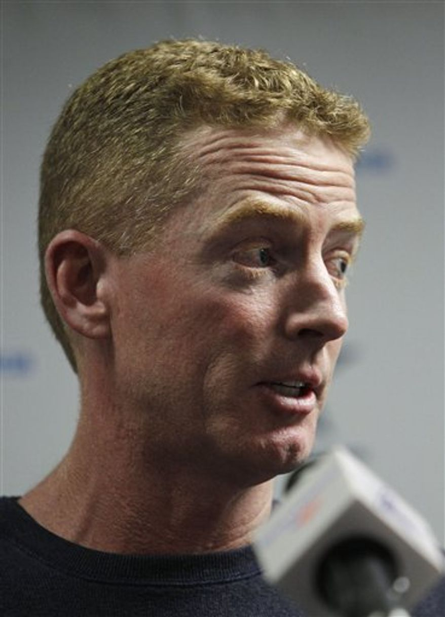 Jason Garrett responds to questions during a news conference after being named interim coach of the Dallas Cowboys, at the NFL football team's training facility Monday, Nov. 8, 2010, in Irving, Texas. Coach Wade Phillips was fired earlier in the day. (AP Photo/Tony Gutierrez)