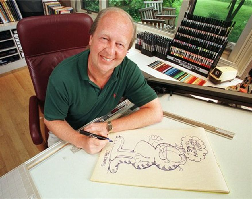 FILE - In this June 9, 1998 file photo, Garfield creator Jim Davis pauses after drawing the cartoon character in his Muncie, Ind., office. Davis apologized Thursday, Nov. 11, 2010, for a Garfield strip that some veterans may have found offensive. (AP Photo/Michael Conroy, File)