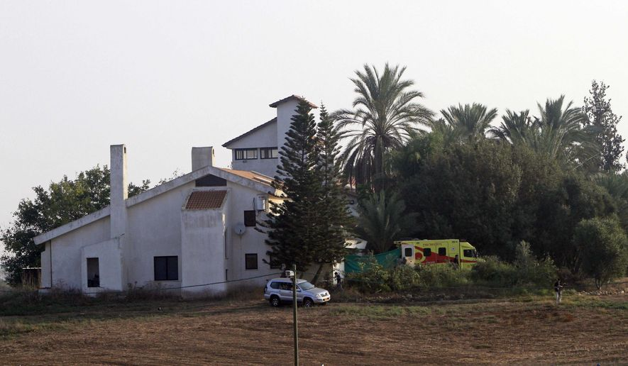 An ambulance that transported former Israeli Prime Minister Ariel Sharon parks next to his home on his ranch, Havat Hashikmim, or Sycamore Farm, near the Negev town of Sderot, southern Israel, Friday, Nov. 12, 2010. (AP Photo/Tsafrir Abayov)