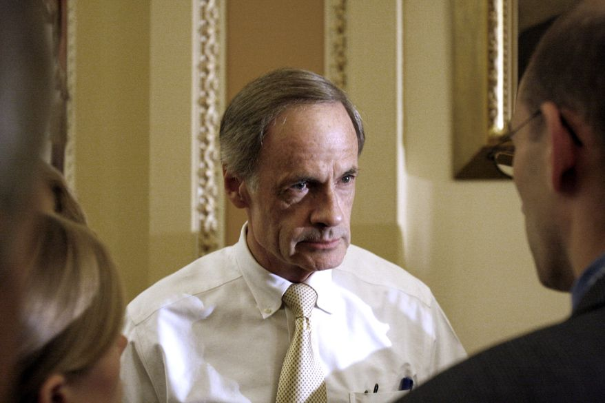 **FILE** Sen. Tom Carper, Delaware Democrat, talks Sept. 30, 2009, to reporters on Capitol Hill in Washington. (Associated Press)