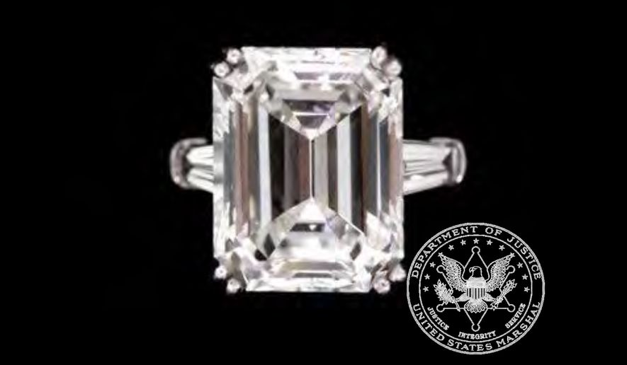 This undated picture made available by Proxibid, Gaston and Sheehan and the U.S. Marshals Service shows a ladies diamond engagement ring, part of thousands of belongings from Bernard Madoff's New York City penthouse on the auction block in New York on Saturday, Nov. 13, 2010. (AP Photo/Proxibid, Gaston and Sheehan, U.S. Marshals Service) ** FILE **