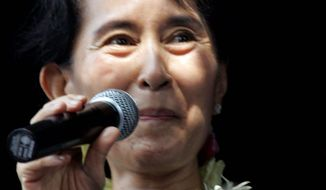 Burma's pro-democracy leader Aung San Suu Kyi delivers speech to supporters at the headquarters of her National ASSOCIATED PRESS