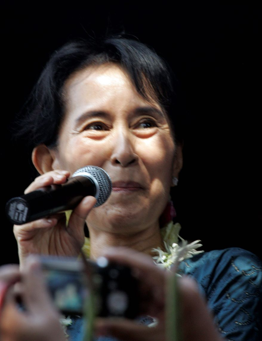 Burma's pro-democracy leader Aung San Suu Kyi delivers speech to supporters at the headquarters of her National ASSOCIATED PRESS Burma's pro-democracy leader, Aung San Suu Kyi, free after seven years of house arrest, addresses thousands of supporters Sunday.