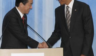 ASSOCIATED PRESS Japanese Prime Minister Naoto Kan, left, shakes hands with President Barack Obama after the leaders declaration at the APEC summit in Yokohama, Japan, Sunday, Nov. 14, 2010.
