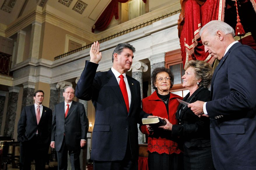 ASSOCIATED PRESS PHOTOGRAPHS Vice President Joseph R. Biden Jr. (right) performs a mock swearing in of Sen-elect. Joe Manchin III, West Virginia Democrat, as interim Sen. Carte Goodwin of West Virginia (left) and Sen. John D. Rockefeller IV, West Virginia Democrat, watch. Mr. Manchin's mother, Mary, and wife Gayle look on.