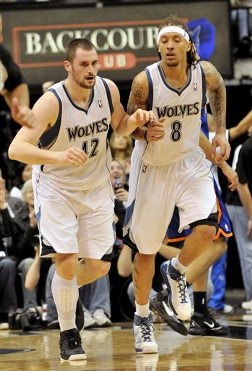 Minnesota Timberwolves' Kevin Love, right, goes up to block a shot by New York Knicks' Amare Stoudemire in the second half of an NBA basketball game Friday, Nov. 12, 2010, in Minneapolis. Love led the Timberwolves with 31 points and 31 rebounds in the Timberwolves' 112-103 win. (AP Photo/Jim Mone)