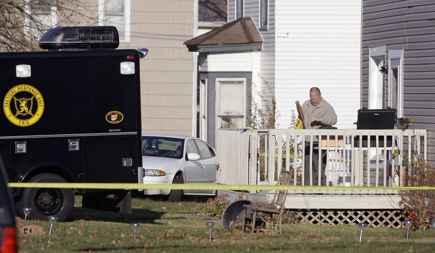 An investigator from the Bureau of Criminal Identification and Investigation processes evidence at the residence of 30-year-old Matthew Hoffman who was arrested for kidnapping Sunday, Nov. 14, 2010, in Mount Vernon, Ohio. The 13-year-old girl who went missing with her mother, brother and a friend was found bound and gagged Sunday in the basement the home, authorities said. (AP Photo/Jay LaPrete)