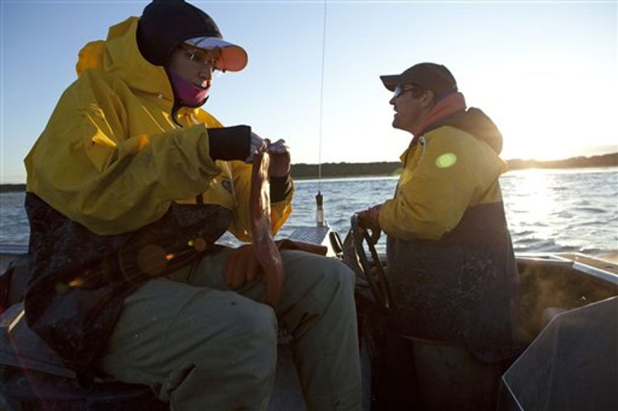 "In this photo taken July 2, 2010 and provided by the Discovery Communications, Sarah Palin waits by her husband Todd's boat before heading up river to see fish being counted in Dillingham, Alaska as part of a documentary for the TLC channel. ""Sarah Palin's Alaska"" is fairly accurate with the facts about her home state. But more spot on is the title of the upcoming TLC documentary series. It's definitely Palin's Alaska, if not anyone else's. The first episode, airing Sunday, portrays the state with a sweeping grandeur not so readibly accessible for Alaskans with less time and money than the former Alaska governor and 2008 Republican vice presidential nominee. (AP Photo/Discovery Communications, Gilles Mingasson)  NO SALES"