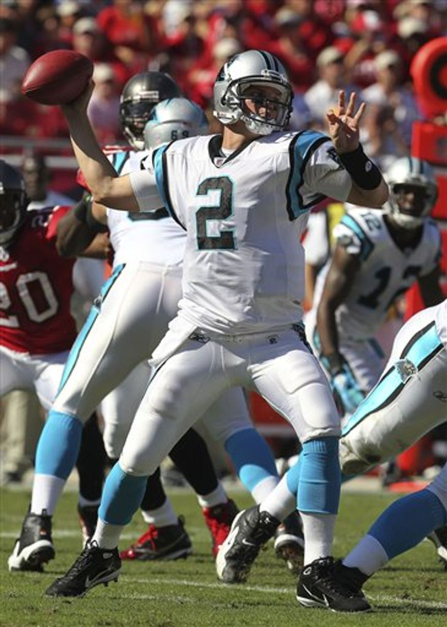 Carolina Panthers quarterback Jimmy Clausen (2) throws a first half pass during an NFL football game against the Tampa Bay Buccaneers Sunday, Nov. 14, 2010, in Tampa, Fla. (AP Photo/Margaret Bowles)