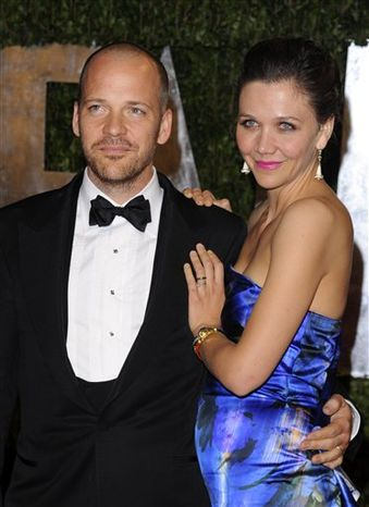 FILE - In this March 7, 2010 file photo, Peter Sarsgaard, left, and Maggie Gyllenhaal arrive at the Vanity Fair Oscar party in West Hollywood, Calif. (AP Photo/Peter Kramer, file)