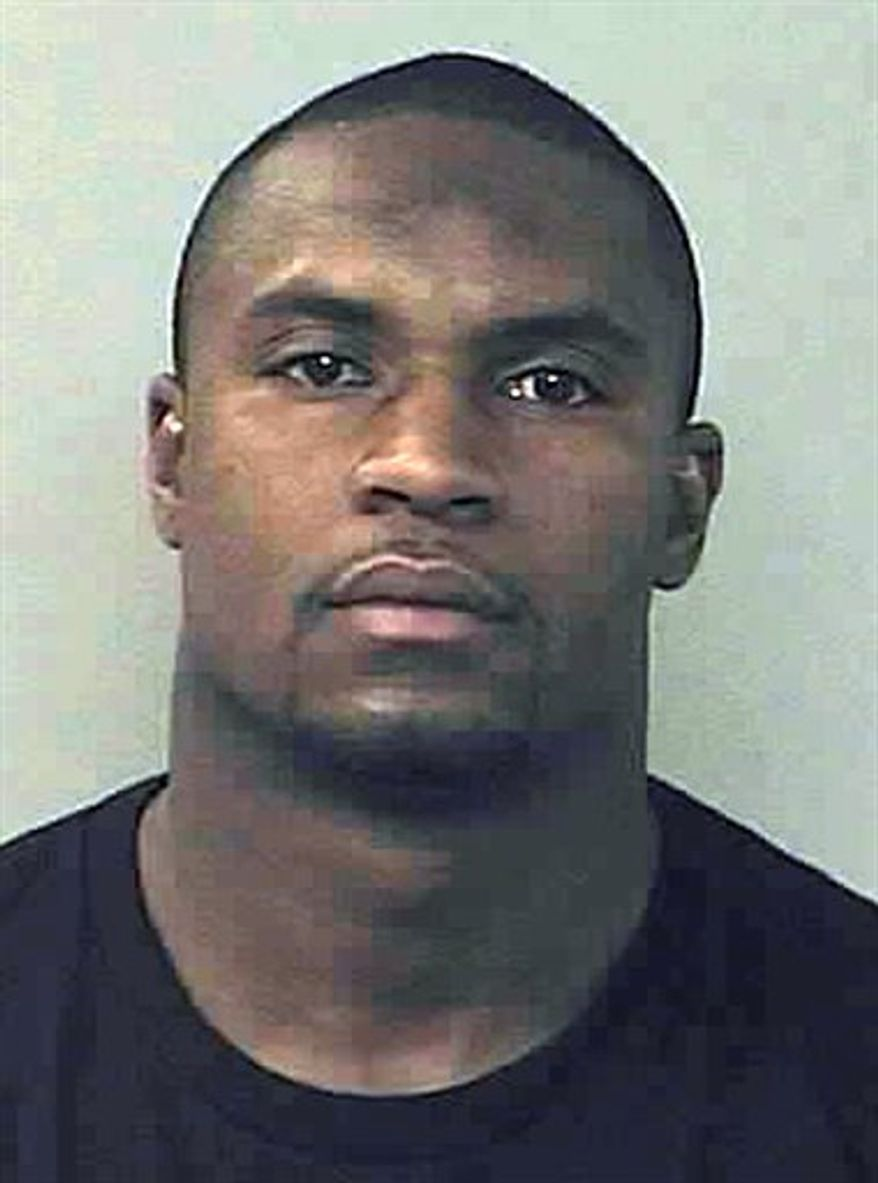 This booking photo provided by the Denver Police Department shows Denver Broncos linebacker D. J. Williams after he was arrested in Denver early Friday, Nov. 12, 2010, and charged with driving under the influence. (AP Photo/Denver Police)